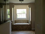 Antigua - masterbath-garden-tub, walk-in shower on left