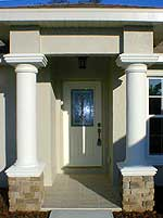 Exterior concrete block walls with stucco finish, decorative features and doors per plans - click to open larger image in new window